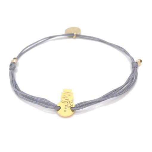 Armband mit goldenem Schneemann und grauem Stoffband